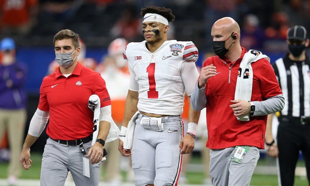 Justin Fields walks off the field injured