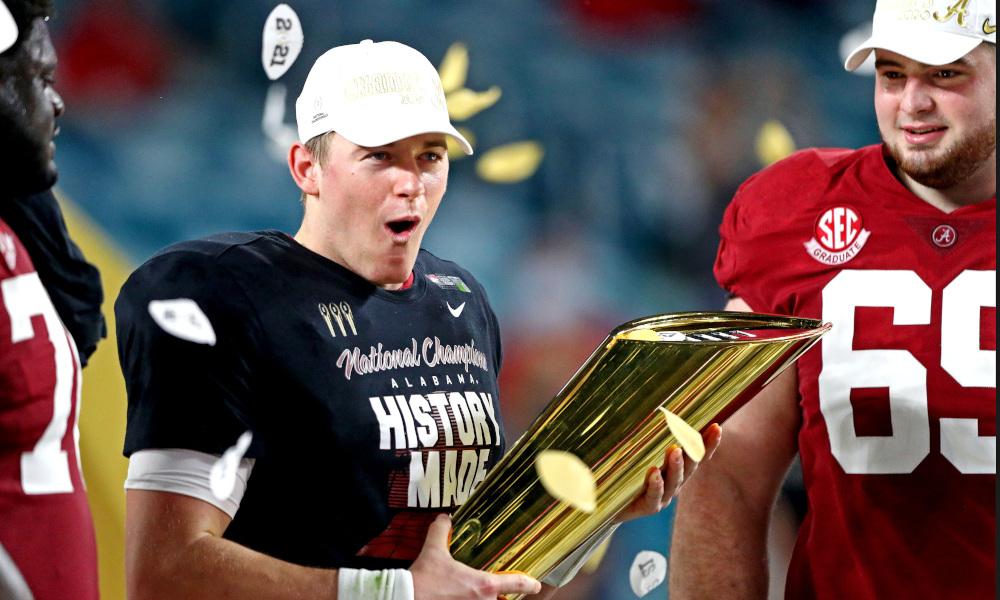 Mac Jones of Alabama holds the 2021 CFP Trophy