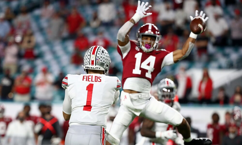 Brian Branch defends a pass versus Justin Fields and Ohio State in 2020 CFP title game