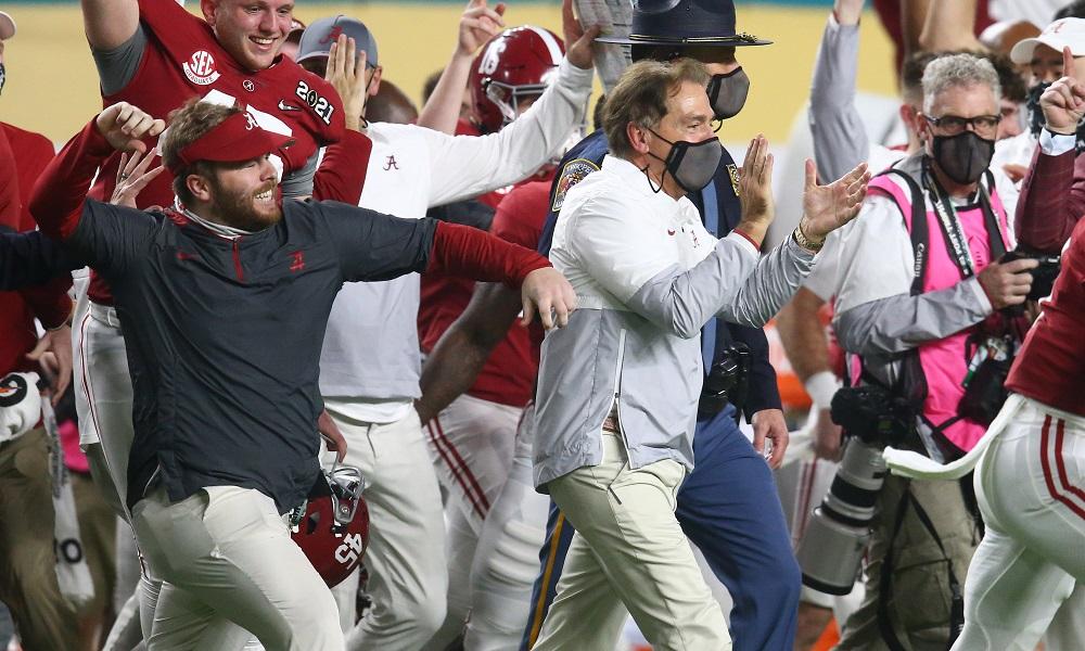 Alabama football and Nick Saban runs on the field after the National Championship win