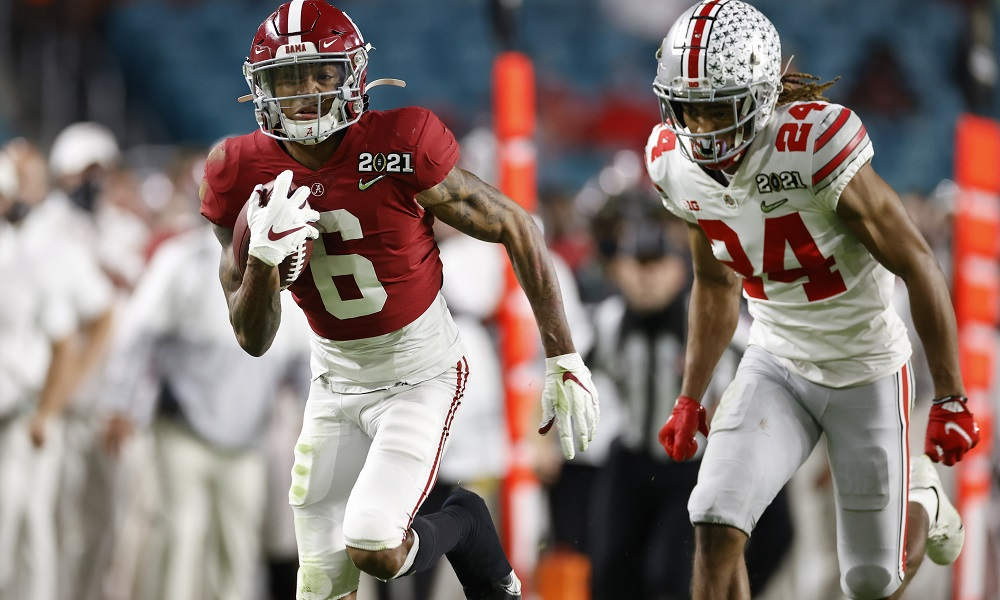 Alabama's DeVonta Smith runs by Shaun Wade of Ohio State for a touchdown in 2020 CFP title game