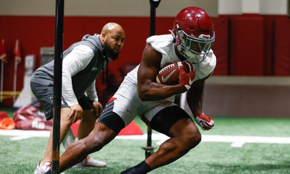 Brian Robinson goes through drills during practice