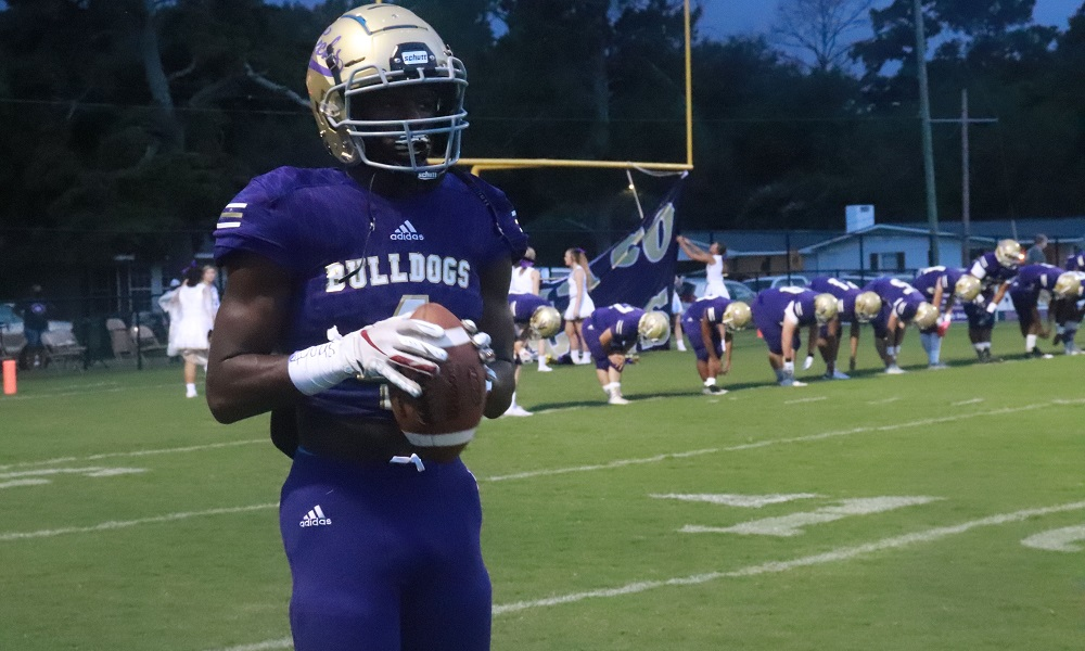 Alabama running back commit, Emmanuel Henderson Holds the football