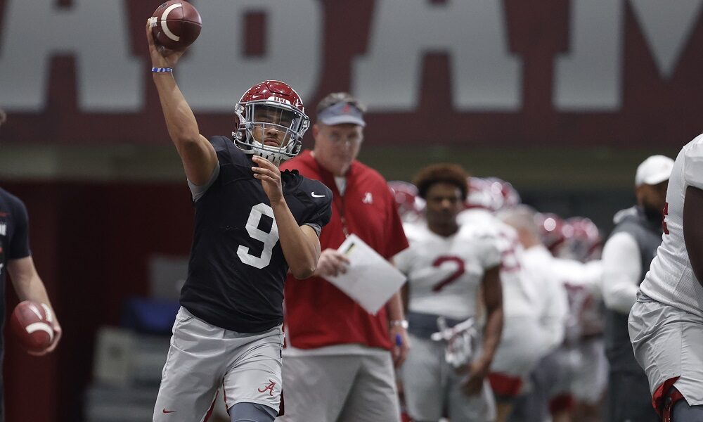 Bryce Young throws a pass at Alabama spring practice