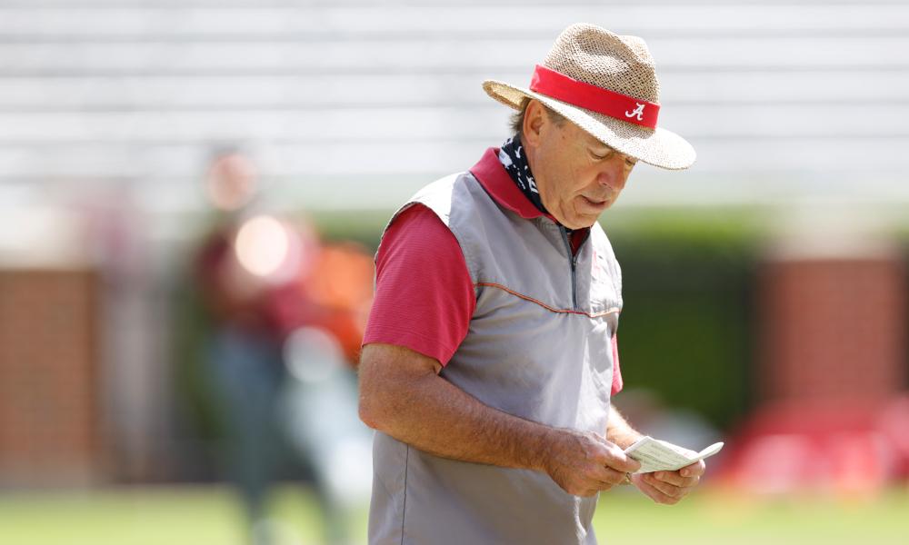 Nick Saban looking at the play sheet at Alabama's second scrimmage