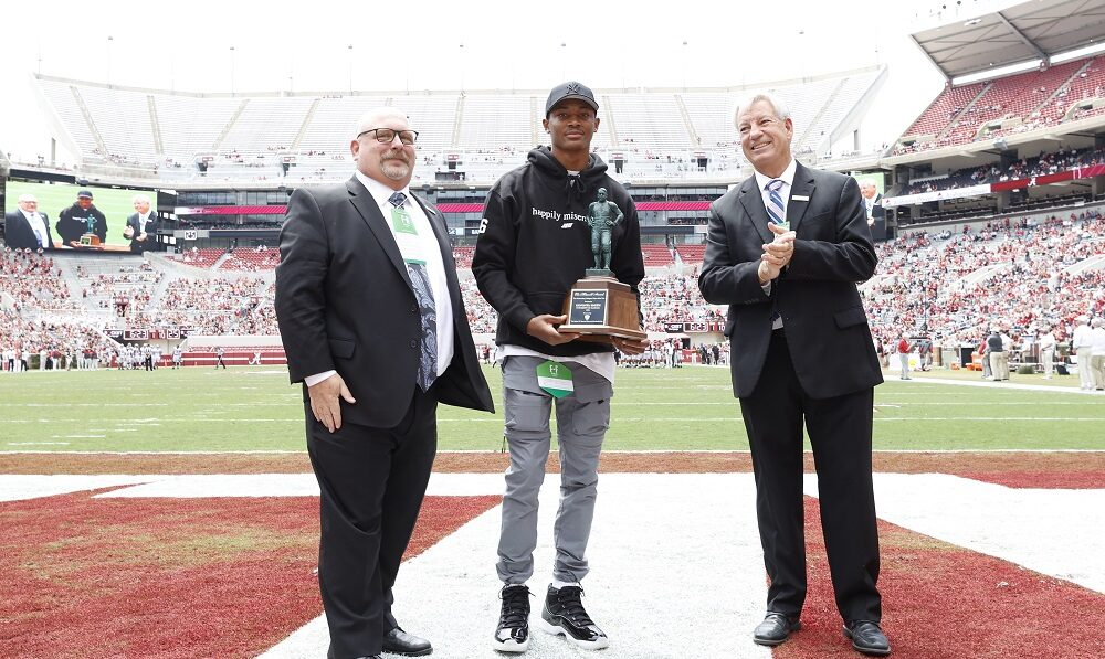 DeVonta Smith holding the Maxwell Award he won from 2020 season