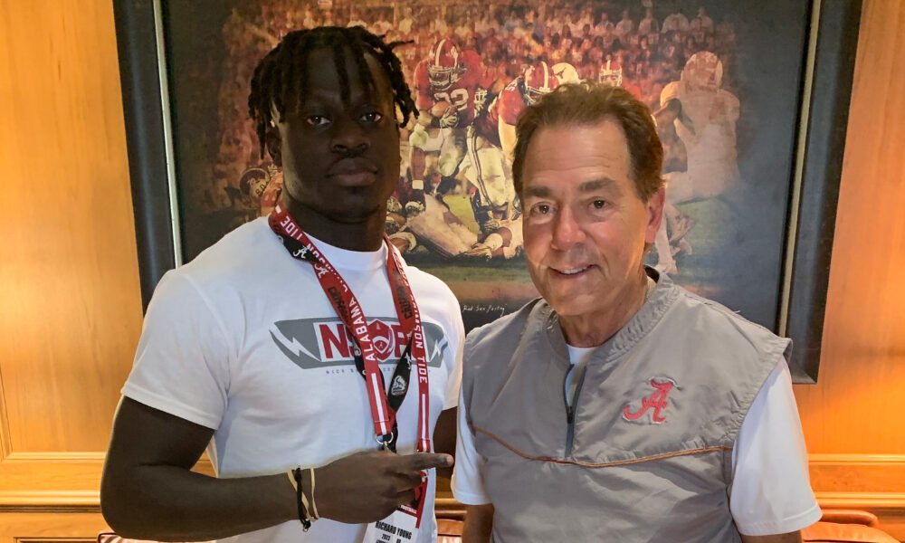 Richard Young takes picture alongside Nick Saban