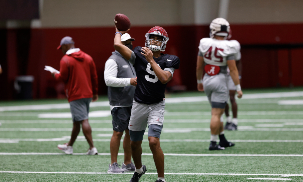 Bryce Young throws a pass during Alabama fall practice