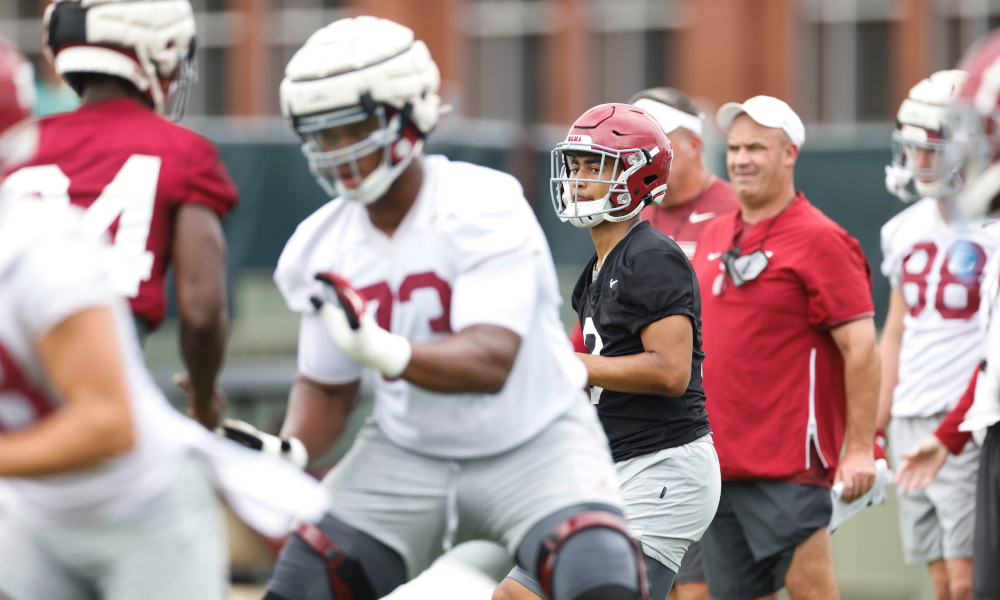 Bryce Young drops back in the pocket with the ball at Alabama practice