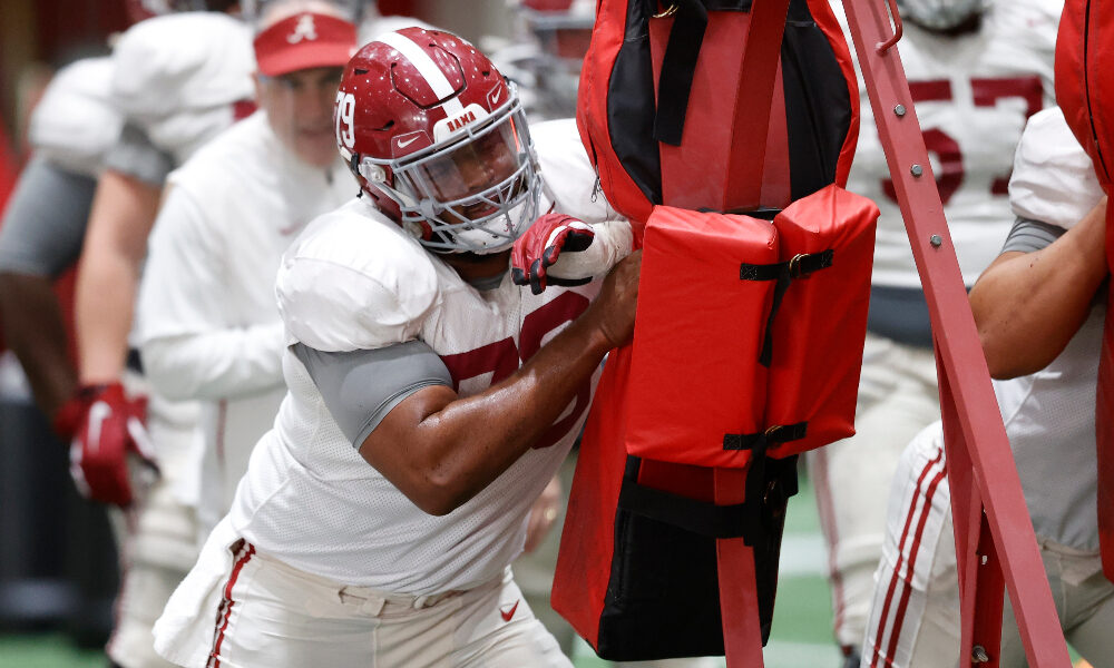 Alabama OL Chris Owens hits the sled at practice