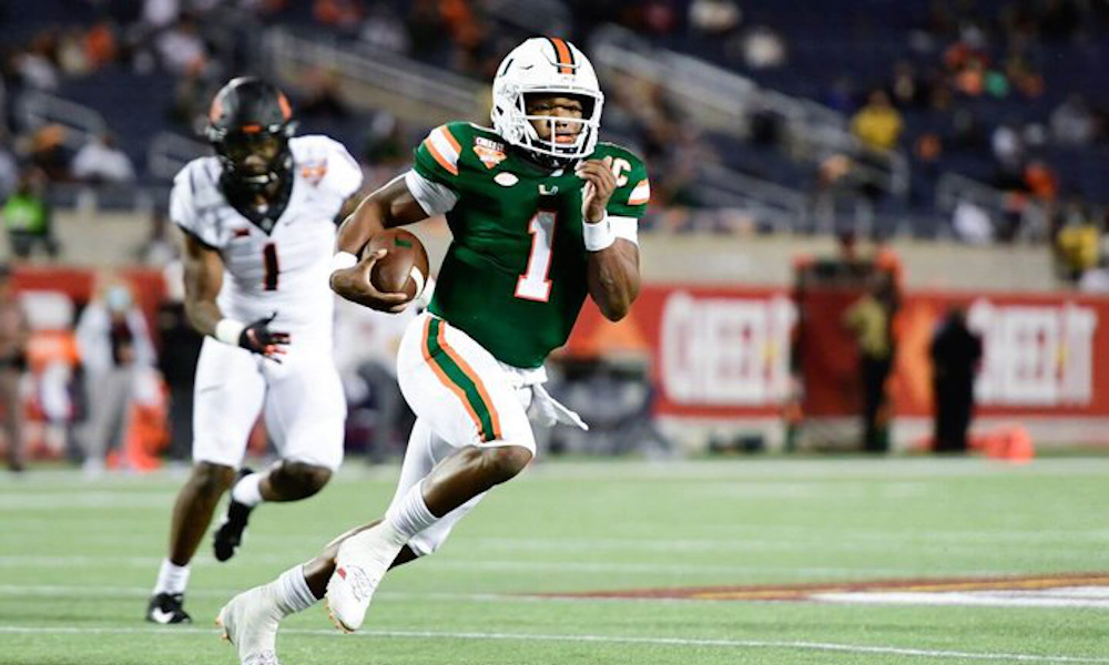 D'Eriq King runs with the ball for Miami versus Oklahoma State in bowl game