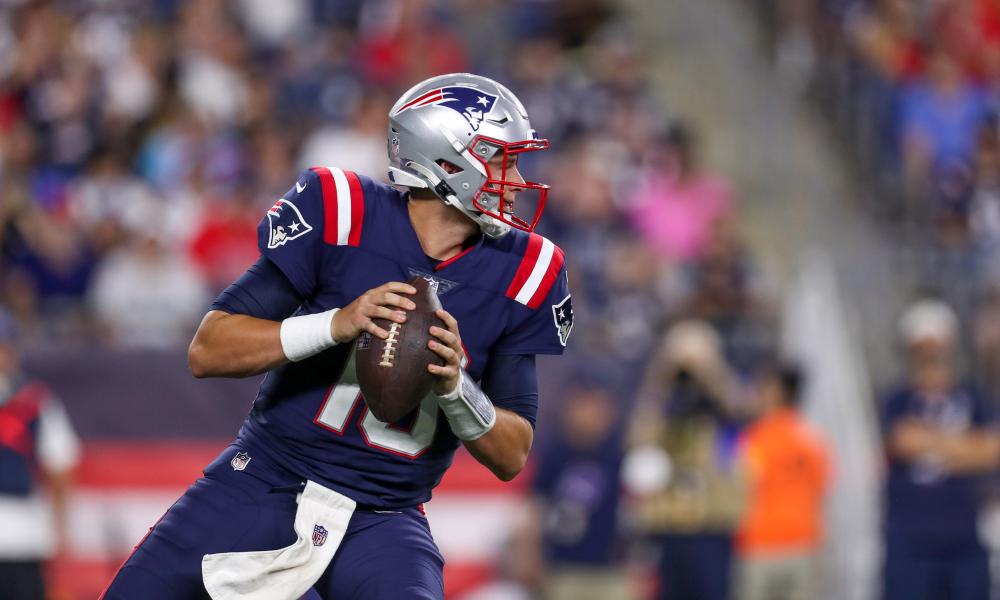 Mac Jones drops back to pass during NFL preseason for Patriots