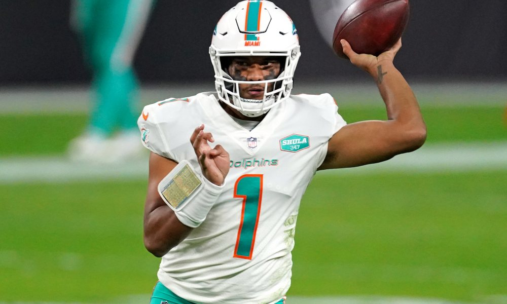 Tua Tagovailoa attempting a pass for Dolphins in 2020 versus Raiders