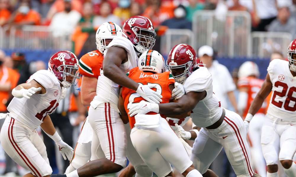 Will Anderson and Phidarian Mathis tackle Miami RB Cam'Ron Harris