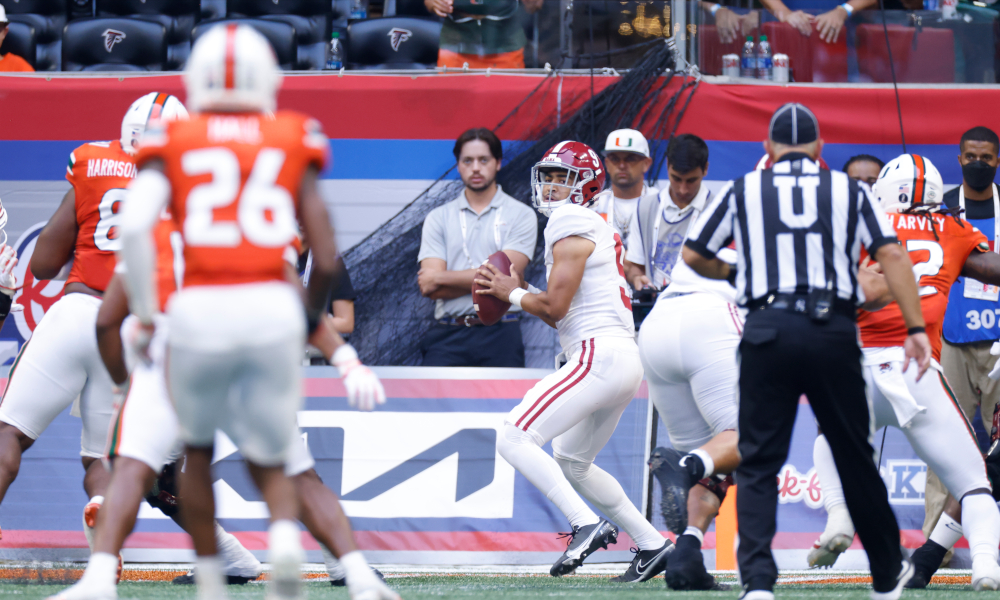 Bryce Young attempts a throw in the pocket for Alabama versus Hurricanes