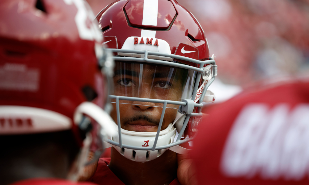 Bryce Young looks on while in Alabama's huddle versus Mercer