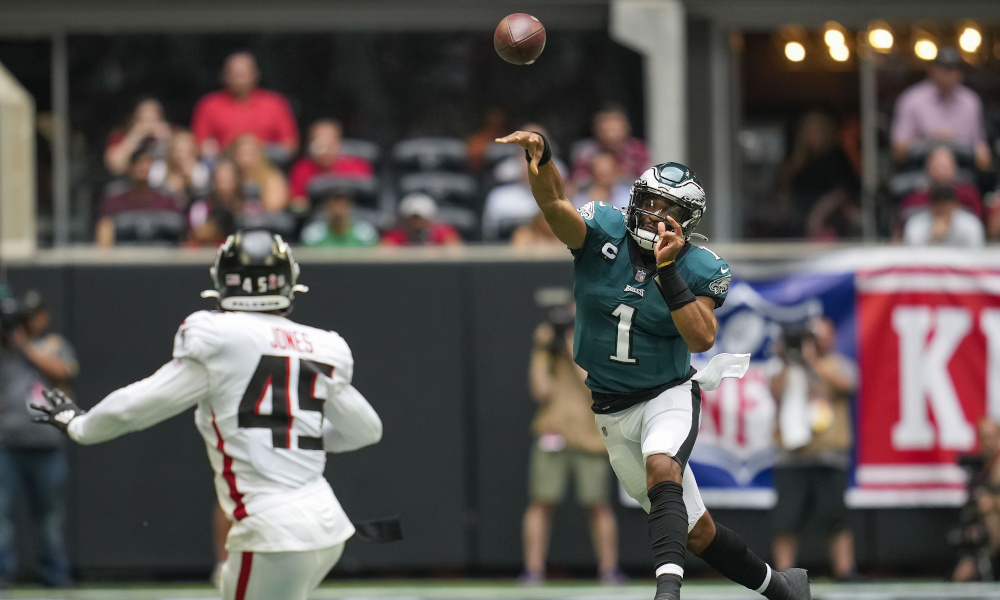 Jalen Hurts with a pass on the run for Eagles versus Falcons