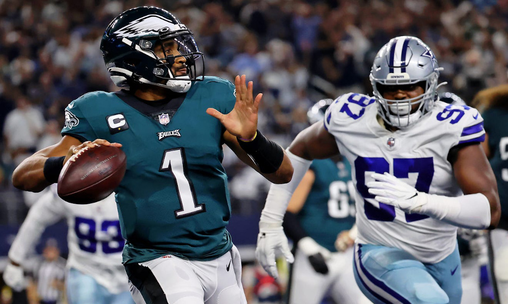 Jalen Hurts (#1) throws a pass for Eagles versus Cowboys