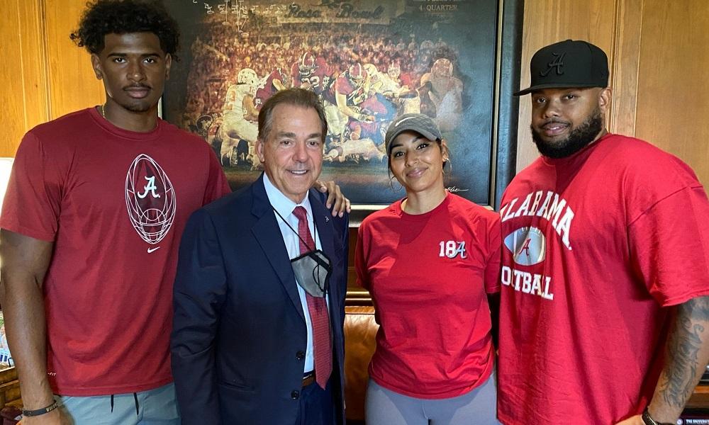 Jayden Wayne poses with Nick Saban and his parents during trip to Tuscaloosa