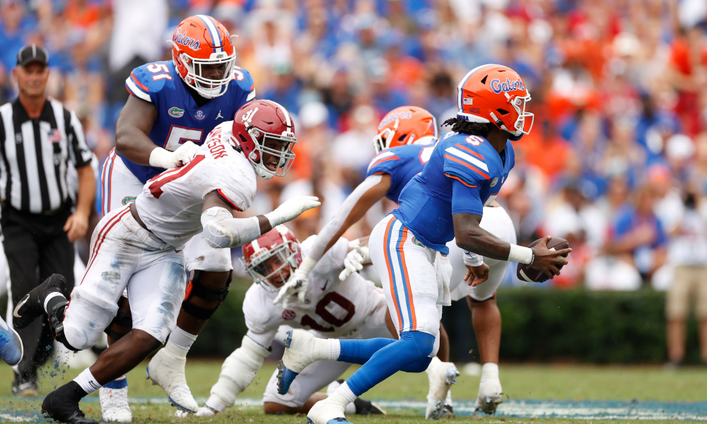 Will Anderson (#31) trying to pressure Emory Jones (#5) of Florida
