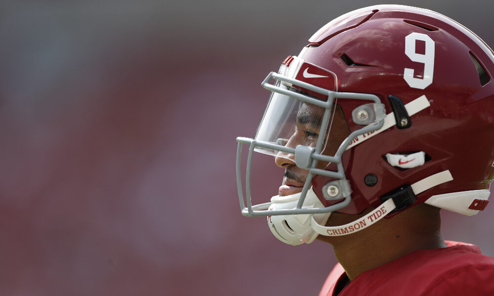 Bryce Young looks to the field at Bryant-Denny Stadium