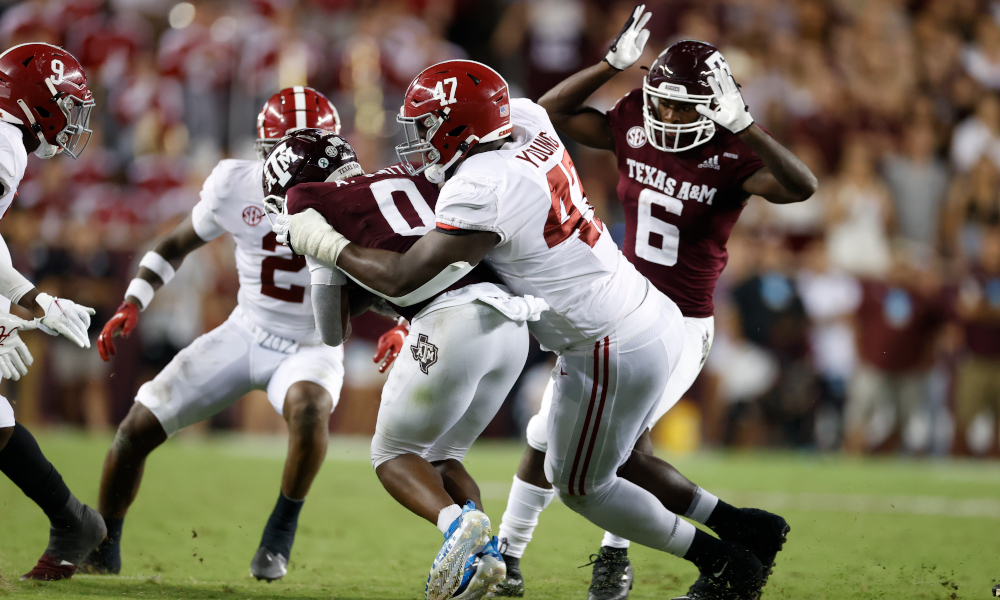 Byron Young (#47) tackles Texas A&M receiver Ainias Smith