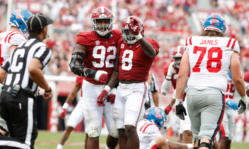 Christian Harris (#8) and Justin Eboigbe (#92) celebrates a stop for Alabama versus Ole Miss