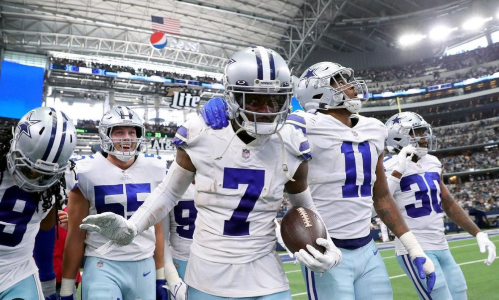 Trevon Diggs celebrates on the sidelines with Cowboys