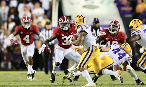 Dylan Moses tackling LSU ball carrier