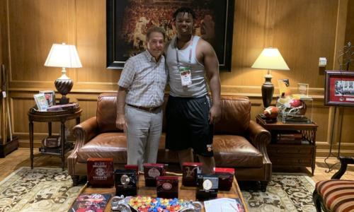 damon payne posing for photo with nick saban